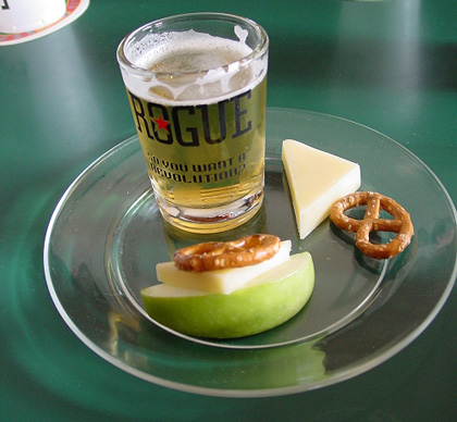 An apple pretzel cheese sandwich